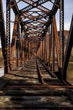 Abandoned & Collapsing Coxton Railroad Bridge - Luzerne County, Pennsylvania. An autumn view of the abandoned and collapsing Coxton Railroad Bridge over the royalty free stock images