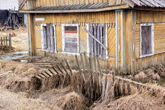 Abandoned collapsing wooden house Stock Photos