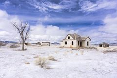Abandoned colorado homestead in winter with snow stock photography