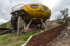 Abandoned colorful pod-styled building. Stock Photos