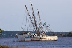 Abandoned Commerical Fishing Boats. Aground and derelict fishing and shrimping boats rusting and unused stock photos