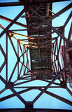 Abandoned complex structure. View from underneath a complex metal structure on blue sky. 35mm film scan Royalty Free Stock Image