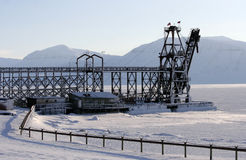 The abandoned  constractions for coal shipping on the outskirts of Pyramiden. Royalty Free Stock Photography