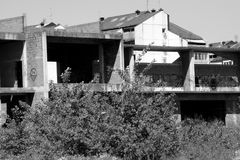 Abandoned construction site. Abandoned old construction site monochrome stock photo