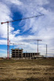 Construction site in development, with cranes in the background Royalty Free Stock Photos