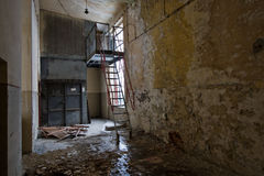 Abandoned corridor. Grunge abandoned interior of an old factory Stock Photography