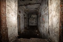 Abandoned corridors of post soviet rocket launch base in latvia. After fire with black walls and metal details royalty free stock image