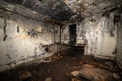 Abandoned corridors of post soviet rocket launch base in latvia. After fire with black walls and metal details stock photography