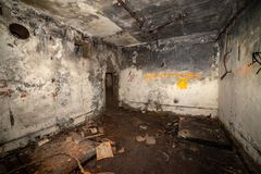 Abandoned corridors of post soviet rocket launch base in latvia. After fire with black walls and metal details royalty free stock photo