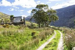 Abandoned Cottage And Mountain Track Royalty Free Stock Images