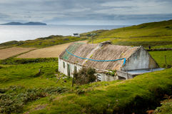 Abandoned cottage. Clare Island, Ireland. August 28, 2004. Abandoned cottage with thatched roof Royalty Free Stock Images