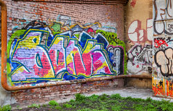 Abandoned courtyard with colorful abstract graffiti Stock Photo