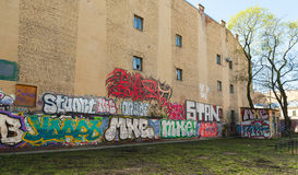 Abandoned courtyard with colorful graffiti Royalty Free Stock Photo