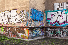 Abandoned courtyard with colorful graffiti text Royalty Free Stock Image