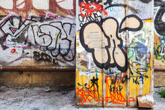 Abandoned courtyard interior with colorful graffiti Stock Photos