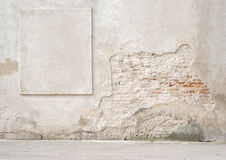 Abandoned cracked brick wall with a stucco frame Royalty Free Stock Photos