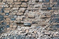 Abandoned cracked and destroyed gray brick wall closeup Stock Photos