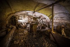 Abandoned creepy dark cellar full of junk and coal stock image