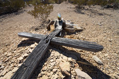 Abandoned cross in Texas ghost town. Broken weather worn cross on top of abandoned tomb in Texas ghost town Terlingua Royalty Free Stock Image
