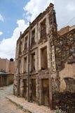 Abandoned crumbling hotel facade Stock Photos