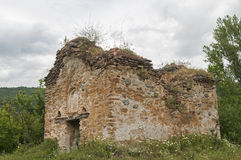 Abandoned crumbling medieval chapel Stock Photo