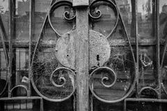 Abandoned Crypt Gate. A cobweb-strewn entrance gate to an abandoned crypt in Recoleta Cemetery, Buenos Aires Stock Image