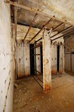 Abandoned degraded building. Room in abandoned building with rusty pipe system Royalty Free Stock Photo