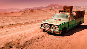 Abandoned in the desert. Remains of an abandoned vehicle Atacama Desert Stock Photography