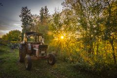 Abandoned old tractor sunset shot Royalty Free Stock Images
