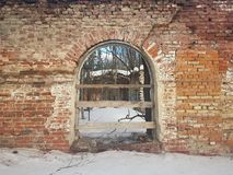 Abandoned and destroyed red brick building in winter stock image