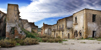 Abandoned destroyed town in sicily. Abandoned Sicilian town of Poggioreale, damaged in 1968 earthquake. in the wall it can see an old written DUX, referred to stock images