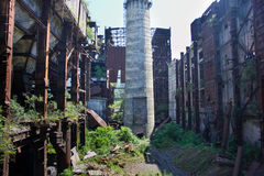Abandoned, destroyed by war and overgrown machinery of Tkvarcheli power plant Stock Photography