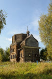 Abandoned destroyed wooden church in northern russian village Royalty Free Stock Photos