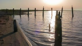Abandoned destroyed wooden pier on lake at dawn stock footage