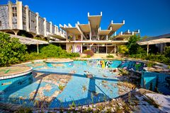 Abandoned and destructed luxury hotel exterior. Krk, Croatia, August 31 2017: Abandoned and destructed luxury hotel Palace Haludovo in Malinska, Island of Krk Royalty Free Stock Images
