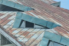 Deteriorated roof detail. Abandoned and deteriorated brick house detail stock photography