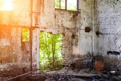 Abandoned building, Ukraine. Abandoned and devastated building in rays of the sun. Ukraine, Donbass. The concept of the fighting force and war stock image