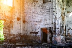 Abandoned building, Ukraine. Abandoned and devastated building in rays of the sun. Ukraine, Donbass. The concept of the fighting force and war stock photography