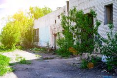 Abandoned building, Ukraine. Abandoned and devastated building in rays of the sun. Ukraine, Donbass. The concept of the fighting force and war royalty free stock photography