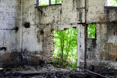 Abandoned building, Ukraine. Abandoned and devastated building in Ukraine, Donbass. Forgotten place. The concept of the fighting force and war royalty free stock photo