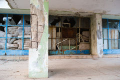 Abandoned devastated hospital main entrance. Abandoned building in bad condition stock photos