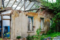 Abandoned house, Ukraine. Abandoned and devastated house in Ukraine, Donbass. Forgotten place. The concept of the fighting force and war stock photography