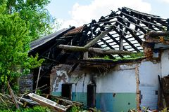 Abandoned house, Ukraine. Abandoned and devastated house in Ukraine, Donbass. Forgotten place. The concept of the fighting force and war royalty free stock photo
