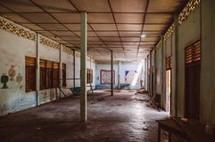 Abandoned devastated school class room with natural light through window royalty free stock photo