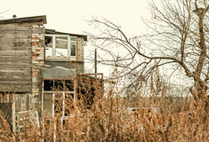 Abandoned dilapidated house autumn day Royalty Free Stock Photography