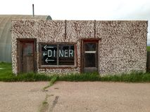Abandoned diner. Abandoned diner along lonely road in Wyoming. Maybe a bigger sign was needed Royalty Free Stock Image