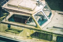Abandoned Dirty Boat. Abandoned Dirty Motorboat in the Marina. Closeup Photo Royalty Free Stock Image