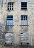 Abandoned disused old derelict factory or mill building Royalty Free Stock Images