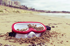 Abandoned diving mask on the beach Stock Images