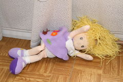 Abandoned doll. On the floor of the children's room Royalty Free Stock Photography
